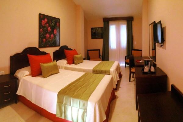 E Central Hotel Bedroom