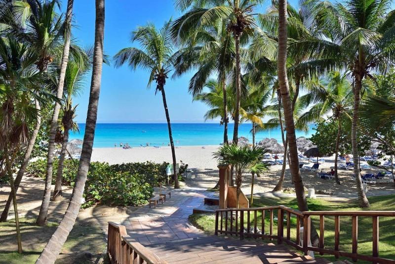 Melia Las Americas, Varadero beach view through palm trees