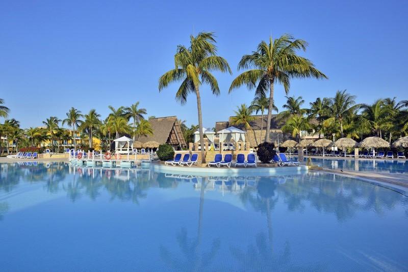 Melia Las Antillas, Varadero beach view through palm trees