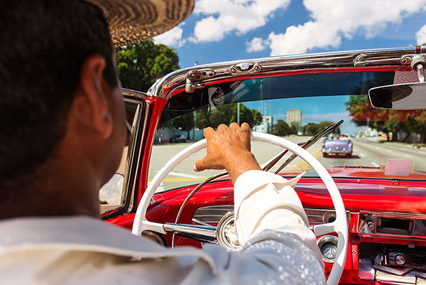 Essential Cuba Tour, Man driving Car